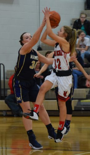 Union Local's Hannah Porter goes up for a shot against Magnolia's Kyndra Pilant during Monday's game in Morristown.