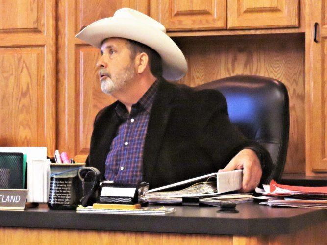 BELMONT COUNTY  Commissioner Matt Coffland wears his cowboy hat in protest of the planned changes to the former Jamboree In The Hills  festival, now called Jambo County. He also brought a cooler to the board of commissioners meeting.  T-L Photo/ ROBERT A. DEFRANK