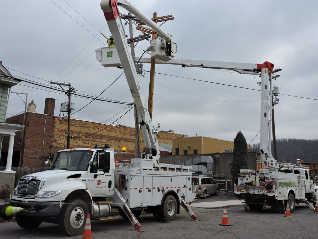 T-L Photo/JANELL HUNTER AEP workers replace and upgrade a utility pole in Martins Ferry.