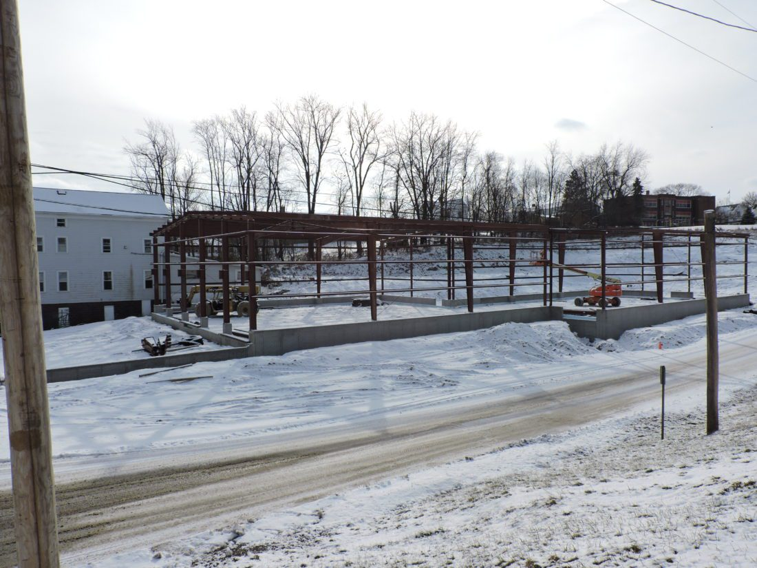 Belmont Mills is expanding its business by building a new 10,000-square-foot structure that will house a retail store and seed blending facility.