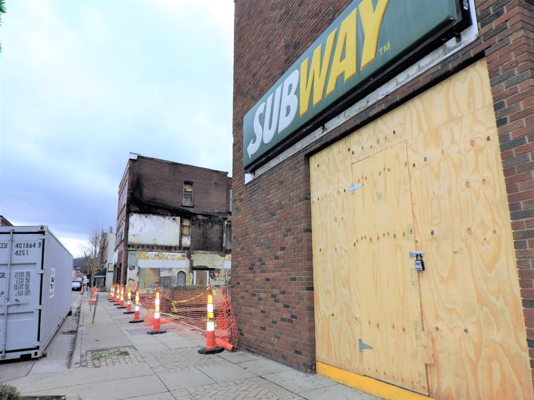 T-L Photo/SHELLEY HANSON WORK to fix the inside of Martins Ferry Subway restaurant is expected to resume as soon as electrical lines are repaired behind the building.