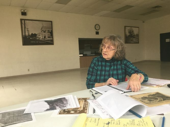 T-L Photo/CRAIG CAMPBELL Helen Bundorf displays historical documents and pictures of Shadyside