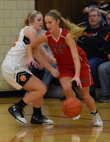 River's Bailey Caldwell drives to the basket as Shadyside's Jaycee Mayeres defends during Monday's game in Shadyside.