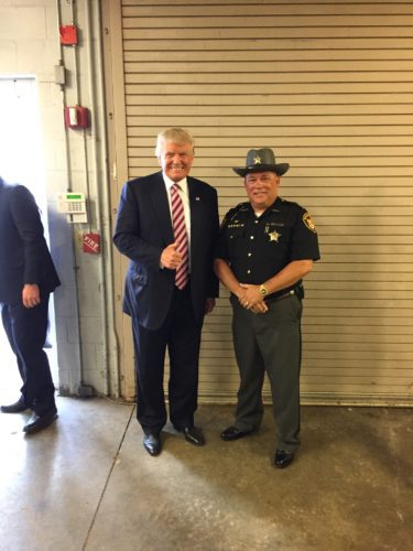 Photo Provided BELMONT COUNTY Sheriff Dave Lucas, right, poses with Donald Trump at a campaign stop during his June 2016 presidential campaign at Ohio University Eastern. Trump's inauguration as the 45th president of the United States was held at noon today.
