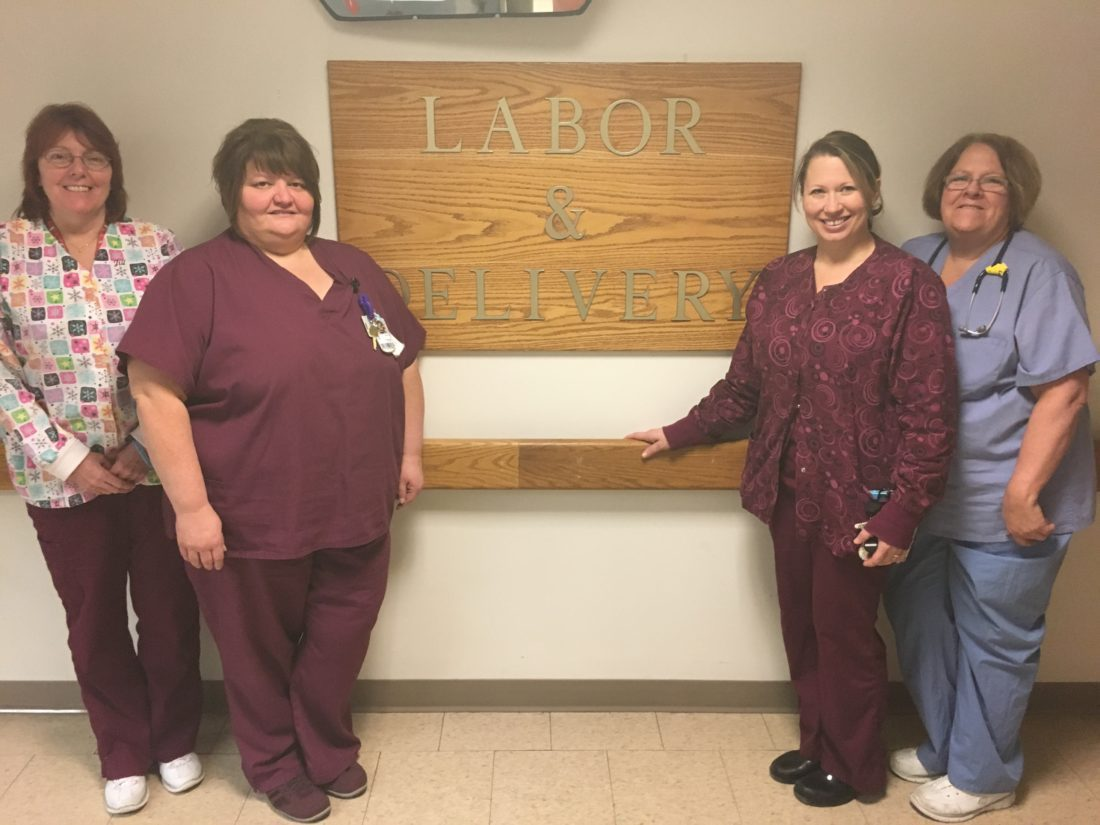 T-L Photo/CRAIG CAMPBELL Staff members at Ohio Valley Medical Center in Wheeling pose outside the Labor & Delivery Department. They include, from left, Jill Heller, charge nurse; Lynette DeBertrand, nurse manager; Anita Shelek, staff nurse; and Lois Harris, charge nurse.