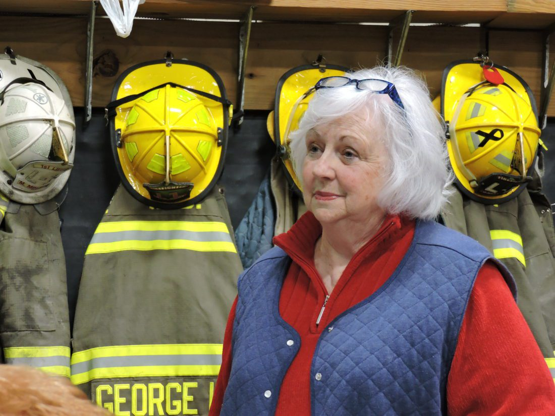 T-L Photo/JANELL HUNTER City Auditor Rita Randall discusses funding for the Eighth Street slip repair project with Martins Ferry City Council at the Martins Ferry Volunteer Fire Department Ladder Company station on Wednesday.