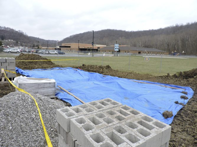 T-L Photo/DYLAN McKENZIE  Freshly turned earth and construction supplies sit beside the softball field at the Bridgeport Exempted Village Schools, part of a project to build a new concession stand and restrooms for the school.