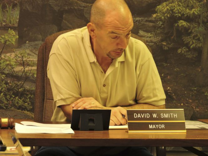 T-L Photo/DYLAN McKENZIE  Bridgeport Mayor David Smith looks over the agenda at Tuesday's village council meeting.