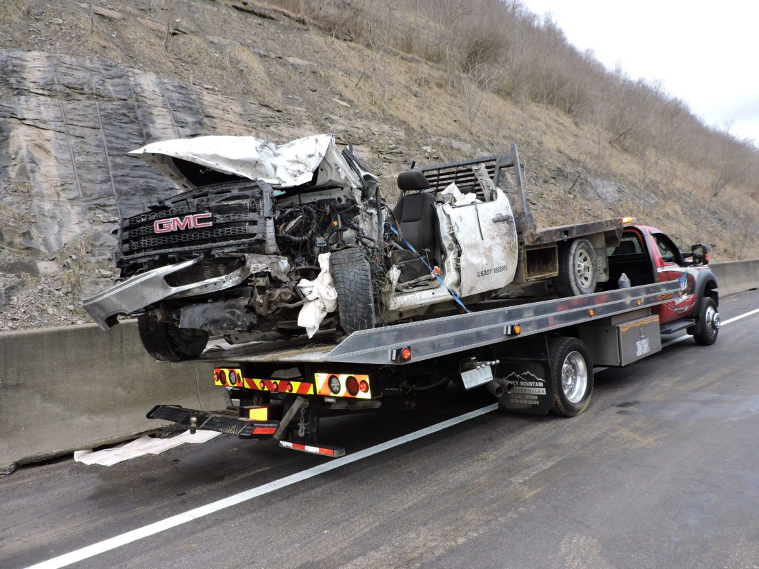 T-L Photo/SHELLEY HANSON THE DRIVER of this pickup truck hit by a tractor-trailer this morning on Ohio 7 near Powhatan was transported via medical helicopter to UPMC Presbyterian Hospital in Pittsburgh.