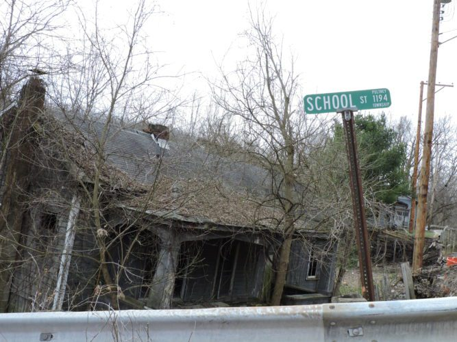 Photo by Casey Junkins This dilapidated structure with trees growing through it sits at the intersection of School Street and Ohio 149 in the Belmont County community of Neffs.