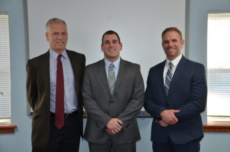 T-L Photo/KIM NORTH THOMAS DALEY, center, is the new Bridgeport High School principal. The decision was announced during Wednesday night's regular monthly board of education meeting. He is flanked by board President Don Cash, left, and Superintendent Zac Shutler.