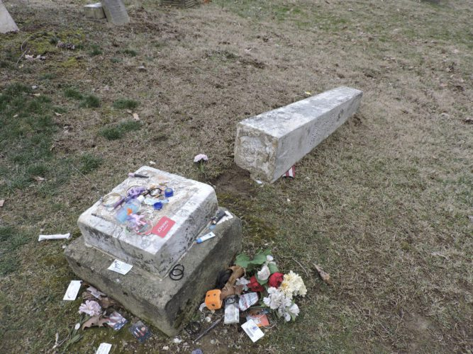 T-L Photo/DYLAN McKENZIE  The stone obelisk marking Louiza Catherine Fox's gravesite lies on its side on the ground Friday. The Belmont County Sheriff's Department has not received any reports of vandalism in the cemetery.