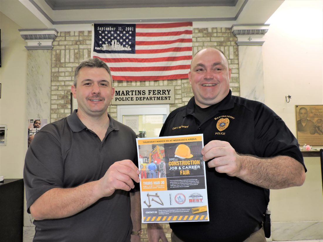 T-L Photo/SHELLEY HANSON DOUG GIFFIN, left, president of the International Brotherhood of Electrical Workers, and Martins Ferry Police Chief John McFarland, who also operates the Belmont County Staying Clean Club, hold a flyer promoting the March 30 Construction Job & Career Fair in Wheeling. They are encouraging drug-free teens to consider a job in a trade as a career.