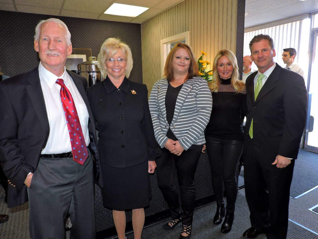 T-L Photo/SHELLEY HANSON PAULL ASSOCIATES Real Estate Ohio staff celebrate the opening of their new office in St. Clairsville. From left are Lee Paull III and his wife, June; Ohio office manager and agent Sonya Olaka; and Jennifer Paull and her husband, Lee Paull IV, the broker for the new office.