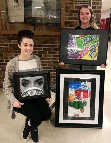 Photos Provided BARNESVILLE High School students Mikayla Willis, left, and Brianna Bohandy won during the Ohio Governor's Youth Art Exhibition. They are holding examples of their artwork created at the school.