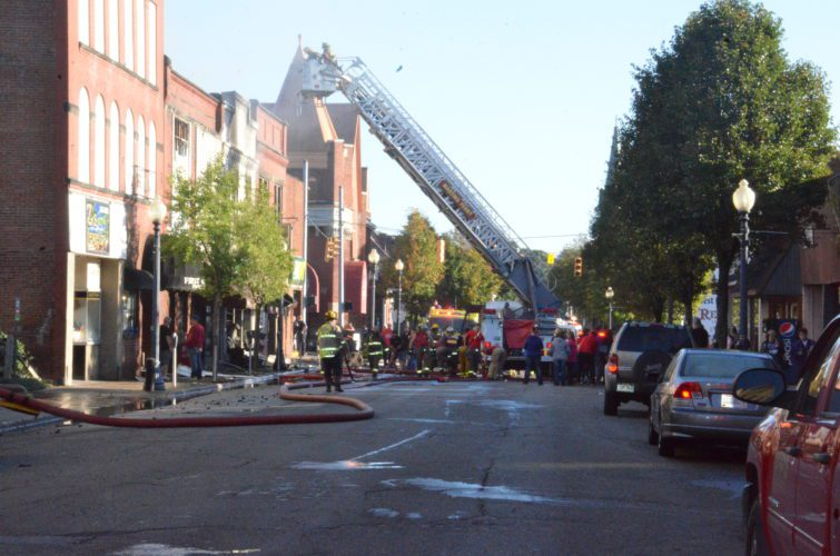 T-L File Photo Firefighters from multiple departments respond to an Oct. 9 blaze on Fourth Street in Martins Ferry that destroyed several businesses. The fire was named the Belmont County Fire & Squad Officers Association's 2016 Incident of the Year, and four energy companies were honored for helping to fight the blaze.