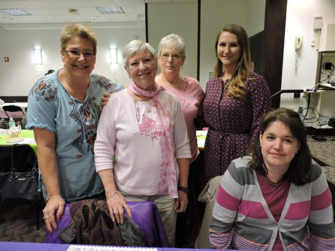 T-L Photo/JANELL HUNTER Breast cancer survivors Diane Duda, Barb Colley and Sharon Strope, from left, and Andrea Strope and Tracy Mosca enjoy their time together at the Seventh Annual Ladies Spring Tea at Wheeling Hospital, sponsored by Schiffler Cancer Center on Thursday.