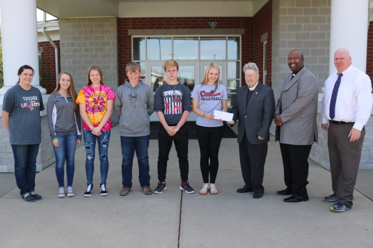 Photo provided MARTINS FERRY Middle School students raised $500 for the Daily Bread Center. The check was presented recently to center officials. From left, are Student Council Advisor Rebekah Shirley, Student Council officers, Jessyca Brady, Ava Doyle, Gary Stoffer, Chase Goff, Kayla Theaker, the Revs. John Brandenburg and James Agnew and Principal Mike Delatore.