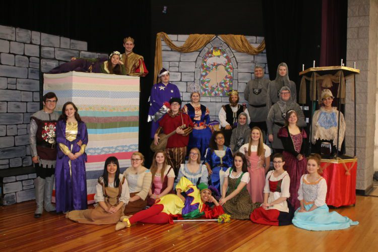 """Photo provided THE CAST of """"Once Upon a Mattress"""" poses in costume on stage at Martins Ferry High School."""