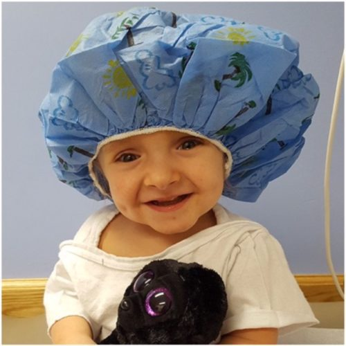 ANNIE  TAGGART smiles in a  medical cap and gown. Due to her condition, Annie has to make  frequent trips to  a specialist in Akron, and the community is holding a benefit dinner on her behalf on May 6.     Photos Provided