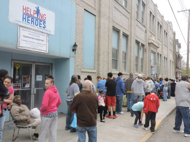 T-L Photo/ROBERT A. DEFRANK Crowds of people show up for the annual Easter food giveaway hosted by the Bethlehem Apostolic Temple. Food and supplies were given away, and police and other first responders assisted.