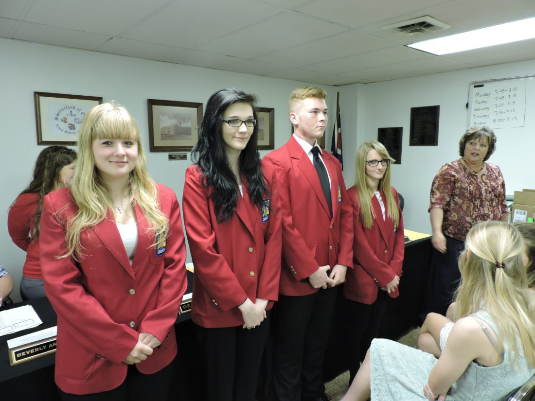 T-L Photo/JANELL  Switzerland of Ohio Local School District students Christina Murphy, from left, Haley Beckett, Tyler Wilson and Brittany Moore placed second at regionals and third at the state level in the Skills USA Competition this year. They were recognized during Tuesday's board of education meeting with their coach, Cathy Vinskovich, right.