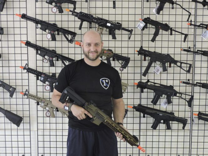 AP Photo ABOVE: Mike Wheeler poses holding one of his favorite Airsoft guns at the Ohio Valley Airsoft store. The store will offer a wide variety of top-of-the line Airsoft guns and equipment to purchase.