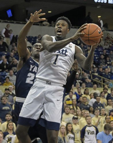 Pittsburgh forward Jamel Artis (1) drives to the basket past Yale guard Miye Oni (24) during the first half of an NCAA college basketball game, Tuesday, Nov. 22, 2016, in Pittsburgh.(AP Photo/Fred Vuich)