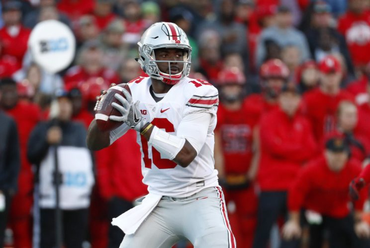 Ohio State quarterback J.T. Barrett looks for a receiver in the first half of an NCAA college football game against Maryland in College Park, Md., Saturday, Nov. 12, 2016. (AP Photo/Patrick Semansky)