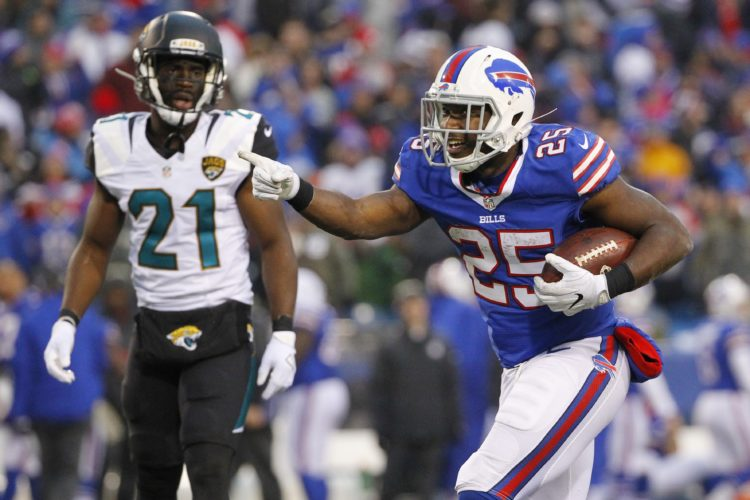 Buffalo Bills running back LeSean McCoy (25) celebrates a first down as Jacksonville Jaguars' Prince Amukamara (21) watches during the second half of an NFL football game Sunday, Nov. 27, 2016, in Orchard Park, N.Y. The Bills won 28-21. (AP Photo/Bill Wippert)