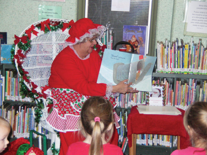 Photo submitted to Times Observer Mrs. Claus plans to share holiday stories, songs, crafts and treats with children in the Warren Public Library Children's Department during Toddler Time on Monday, December 5, at 10:30 a.m. There is another opportunity to visit with Santa's wife at the Library during the After School with Mrs. Claus program on Wednesday, December 7, at 4:30 p.m. Preregistration is not required for Monday's program, but it is appreciated for Wednesday's program. One can stop by the Children's Department to register for the December 7 program on the registration form located next to staff computer, or leave a message for Children's Librarian Susan Slater at 723-4650.