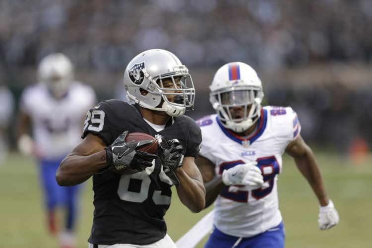 Oakland Raiders wide receiver Amari Cooper (89) runs past Buffalo Bills cornerback Kevon Seymour (29) to score a touchdown during the second half of an NFL football game in Oakland, Calif., Sunday, Dec. 4, 2016. (AP Photo/Ben Margot)