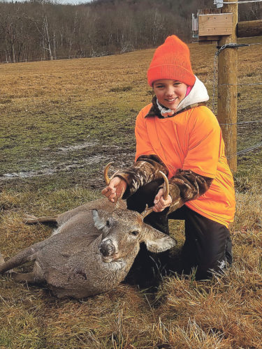 Photo submitted to Times Observer Lilly Newton, 9, of Warren took her first deer, this six-point buck, in Glade Township on Monday, November 28.