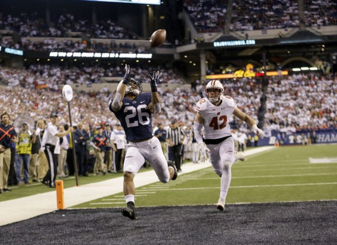 Penn State's Saquon Barkley (26) makes a 18-yard touchdown catch against Wisconsin's T.J. Watt (42) during the second half of the Big Ten championship NCAA college football game Saturday, Dec. 3, 2016, in Indianapolis. (AP Photo/AJ Mast)