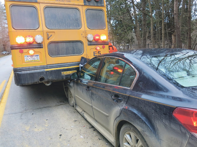 Times Observer photo by Stacey Gross A vehicle traveling south on Jackson Run Road struck the back of a school bus around 4 p.m. on Monday, Dec. 5, just south of Ribs & Bones. According to Pennsylvania State Police, buses ahead of the school bus involved had stopped to let students off at a stop and the driver failed to notice the lights on the bus ahead of him. The bus struck was not carrying students at the time, police and Warren County School District Director of Transportation Mike Kiehl said. There were no injuries, according to police. Assisting at the scene were Lander Fire and Rescue and Sugar Grove ambulance. The car was towed from the scene. A full report will be published when available.