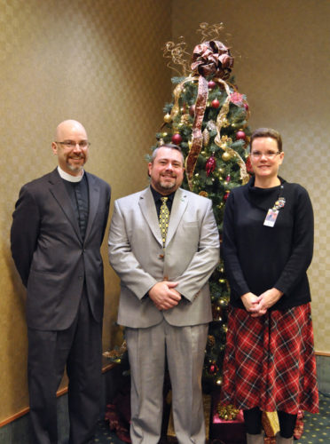 From left are Fr. Matthew Scott of Trinity Memorial Episcopal Church, Ian Hinsdale, and Lisa To, executive director of Hospice of Warren County