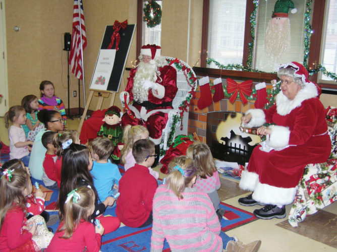 Photos submitted to Times Observer Children at the Warren Public Library ring bells along with Santa and Mrs. Claus as everyone sings Jingle Bells at a holiday program on December 3rd. Children listened to holiday stories, sang songs, iced Christmas tree cookies and made a variety of holiday crafts. All of the children went home with a bag full of books, candy canes and other holiday goodies.