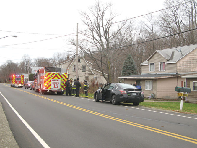 Photo submitted to Times Observer Fredonia, N.Y. police and emergency personnel converge on a property Wednesday in the village following the discovery of a meth lab. Charges have been filed against one of the occupants, with more pending.