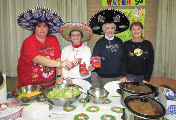 "Pictured are Kristy Wallace, Marilyn Johnson, Connie Lucia and Karen Kays, Youngsville Library staff and friends, who raised funds by providing Tacos at last year's Christmas Walk at the Youngsville Fire Hall. You are invited to come and see the librarian's new ""Taco"" hat this year."