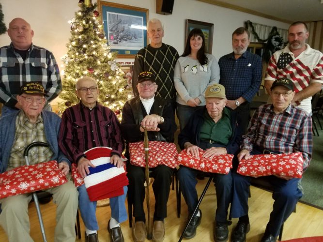 Sugar Grove AMVETS Post 50 recently honored veterans at a dinner to recognize the 75th anniversary of Pearl Harbor. Pictured are, front row, Walter Langford, Henry Stec, Ted Faust, Christy Nelson and Frank Coffaro. Missing from picture were Sam Diglioriao and Morton Williams. Back row, AMVETS officers Jeff VanArsdale, Jim Hannon, Mandy Hitchcock, John VanDewark and Post 50 Commander Travis Hitchcock.