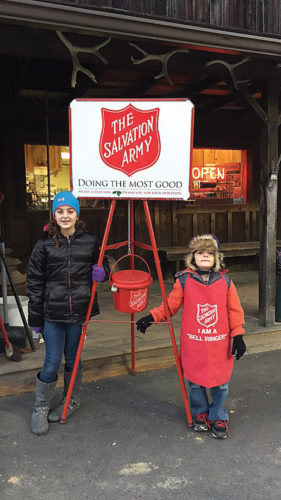 Kaylee Sweitzer spent approximately seven hours ringing the bell for the Tidioute Salvation Army Unit during the month of November.  She is seen here with her younger brother.