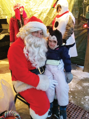 Photos submitted to Times Observer Riley Taylor, age 3, got some quality time with Santa at the Sugar Grove Christmas Walk on Friday night.