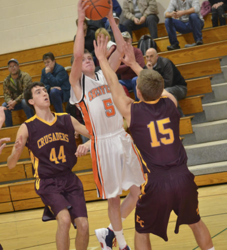 Sheffield's Roger Dunham (5) goes up for a shot over Elk County Catholic's Nate DaCanal (44) and Brad Dippold during Monday's AML contest at Sheffield High School.
