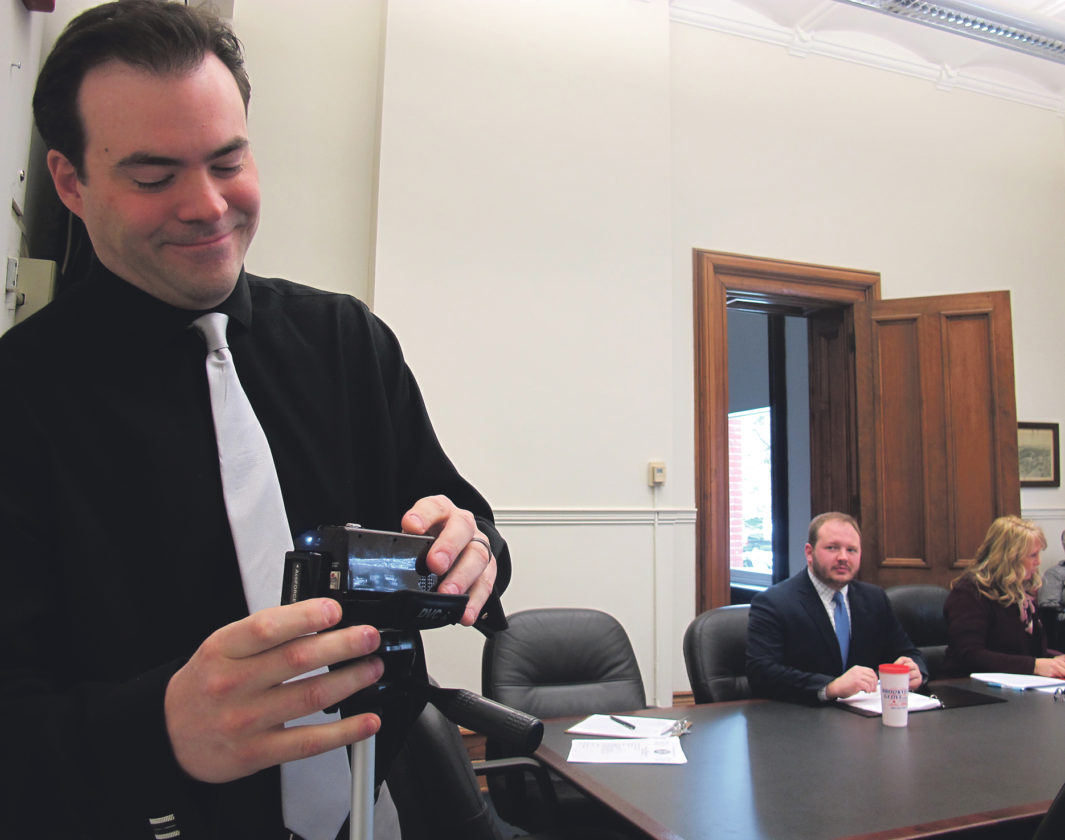 Times Observer photo by Brian Ferry Warren County Commissioner Jeff Eggleston sets up a video camera before the commissioners meeting Monday afternoon.