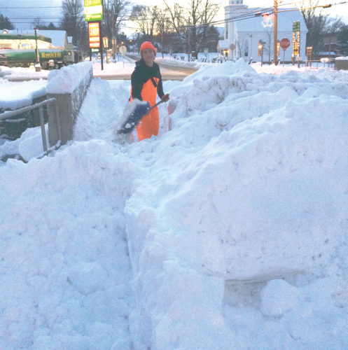 Photo submitted to Times Observer Even when the small plow will not break through all the snow, Joey Bauer grabs his shovel and is on duty to clear all the sidewalks in the borough.