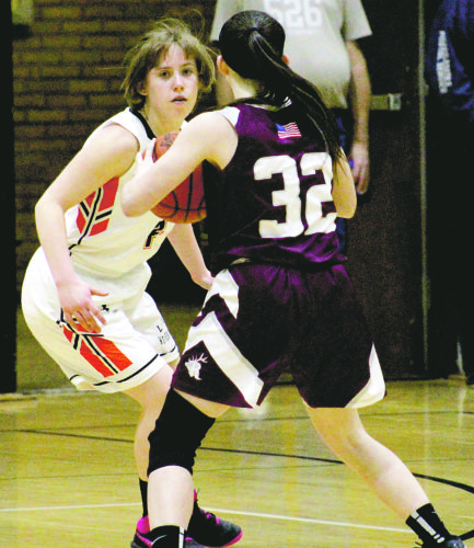 Rosemary Nelson plays tight defense against Ridgway on Friday.