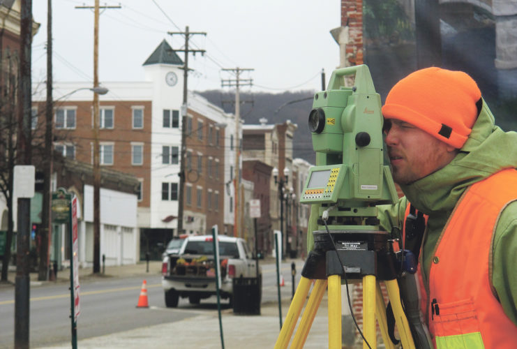 Times Observer photo by Brian Ferry Workers from GPI of North East were surveying Monday at the intersection of Pennsylvania Avenue and Market Street in Warren.