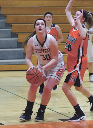Times Observer photo by Ben Oviatt Sheffield's Lexi Lyon (30) makes a move in the post while guarded by Smethport's Katie Treat (50) during Monday's game in Sheffield. Lyon had eight points, nine rebounds and five blocks for the Lady Wolverines in a 41-24 loss.