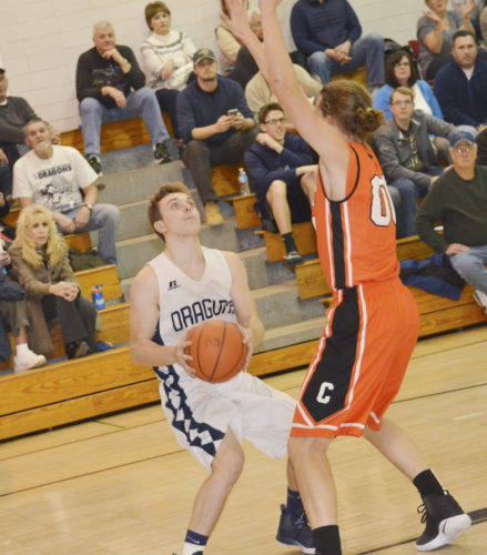 Warren's Kohl Nosel pump fakes against Corry's JP Goodsel during the first half of Monday's game.