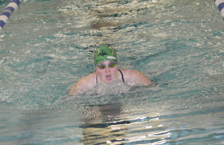 Warren's Sabrina Johnson competes in the 200 freestyle during Thursday's meet against Meadville. The Lady Dragons rolled to their second win of the week.